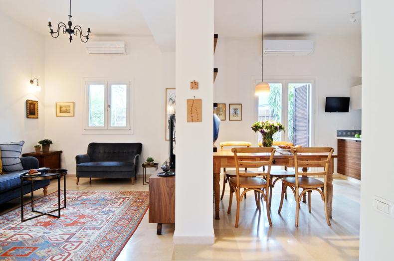 5 תמונה חצויה של המטבח והסלון